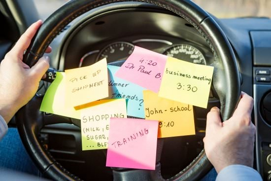 steering wheel with lots of sticky note reminders - what's the priority?