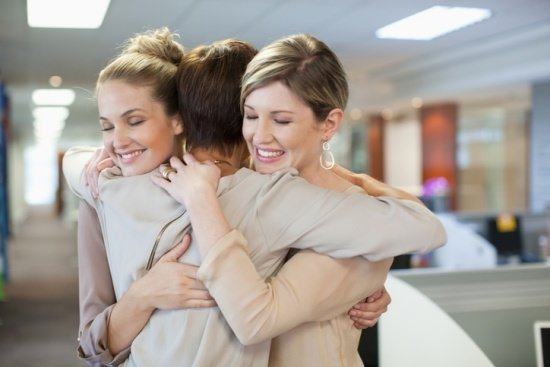 business women hugging for support